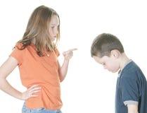 责骂年轻人的男孩女孩 图库摄影