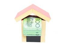货币在房子里 库存图片