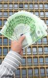 货币在手中 免版税库存图片