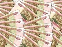 货币堆100俄国卢布票据背景  免版税图库摄影
