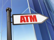 货币概念:在大厦背景的标志ATM 库存照片