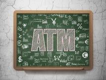 货币概念:在校务委员会背景的ATM 免版税库存照片
