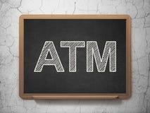 货币概念:在黑板背景的ATM 免版税图库摄影
