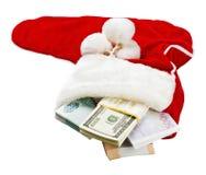 货币环球在圣诞节袜子 库存图片