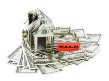 货币的之家从横幅销售额的  免版税图库摄影