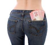 货币装在口袋里您 库存图片