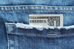 货币装在口袋里 免版税库存照片