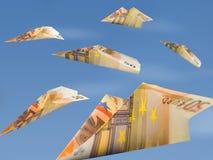 货币飞机 免版税库存图片