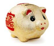 贪心金黄的moneybox 免版税库存图片