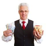 贪心银行经理的货币 库存照片