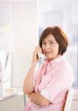 购买权成熟办公室电话纵向工作者 库存照片