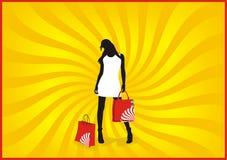 购物的冷静女孩 免版税库存照片