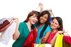 购物的袋子三名妇女 图库摄影