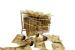 购物车被充塞的货币购物 图库摄影