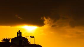 贴水Fokas希腊,在多暴风雨的天气的日出 库存照片
