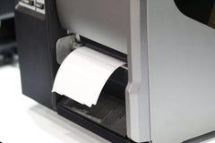 贴纸条形码的标签打印机 免版税库存图片