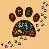贺卡新年快乐 狗爪子和手写的题字版本记录  图库摄影