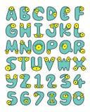 资本字体收藏的有大黄色扭动眼睛的逗人喜爱的矮小的绿色妖怪 库存图片