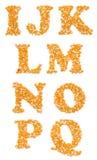 资本字符由玉米种子制成 免版税库存图片