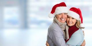 资深夫妇圣诞老人 库存照片