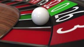 赌博娱乐场轮盘赌的赌轮球击中26黑色 3d翻译 免版税库存照片