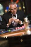 赌博的人轮盘赌表 库存图片