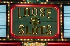 赌博霓虹灯的松散槽 免版税库存图片