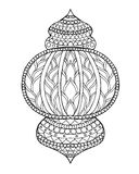 赖买丹月手拉的传统灯笼  图库摄影