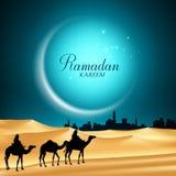 赖买丹月Kareem月亮背景与骆驼的夜 库存照片