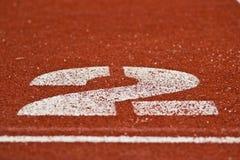 赛跑与编号的运输路线 免版税库存照片