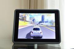 赛跑在苹果计算机Ipad 4视网膜的比赛 图库摄影