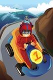 赛跑在去kart的孩子 免版税图库摄影