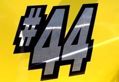 赛跑端的44辆汽车编号 免版税库存图片