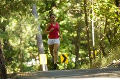 赛跑者妇女年轻人 免版税库存图片