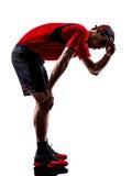 赛跑者慢跑者疲乏的精疲力尽气喘吁吁的热剪影 免版税图库摄影