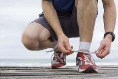 赛跑者鞋带附加 免版税图库摄影