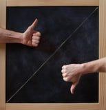 赞许和下来在黑板 免版税库存照片