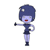 给赞许标志的可笑的动画片吸血鬼女孩 图库摄影