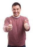 给赞许标志的愉快的人 免版税库存图片