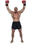 赢取的拳击手画象有被举的胳膊的 免版税库存图片