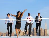 赢取竞争的女商人 免版税库存图片