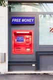 赢得自由兑换货币的红色ATM 库存图片