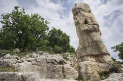 赫拉克勒斯和Antiochus握手片剂在Arsemia古老区域 库存图片