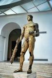 赫拉克勒斯被镀金的古铜色雕象  免版税图库摄影