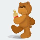 走与瓶的玩具熊刻痕在他的 免版税库存图片