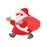 走与袋子的圣诞老人 免版税库存照片