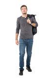 走偶然年轻的人在看照相机的肩膀的推进的夹克 图库摄影