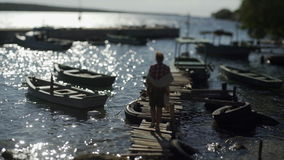 走在木手工制造码头的一个少妇 影视素材
