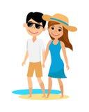 年轻走在海滩的人和女孩 免版税库存图片