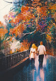 走在秋天公园的恋人夫妇 库存照片